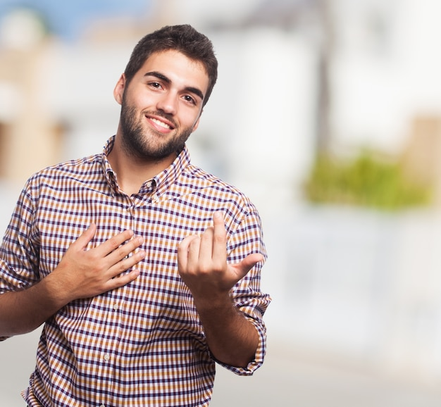 Man gesturing to come closer Free Photo