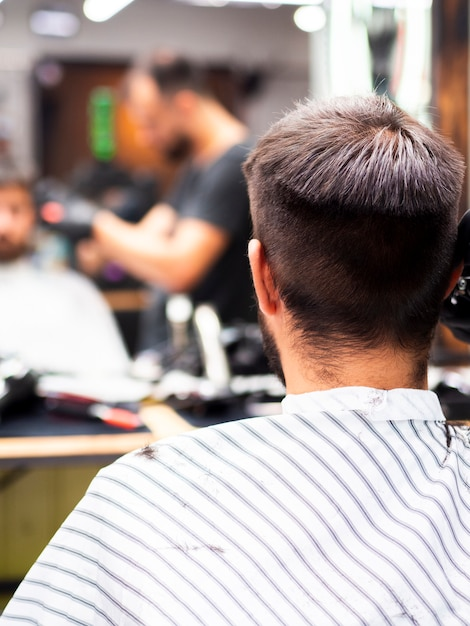 Man getting a new haircut from behind Free Photo