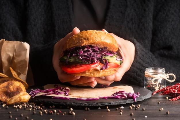 Man getting ready to eat a hamburger Free Photo