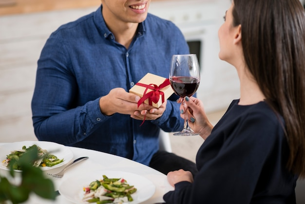 Man giving a gift to his wife Free Photo