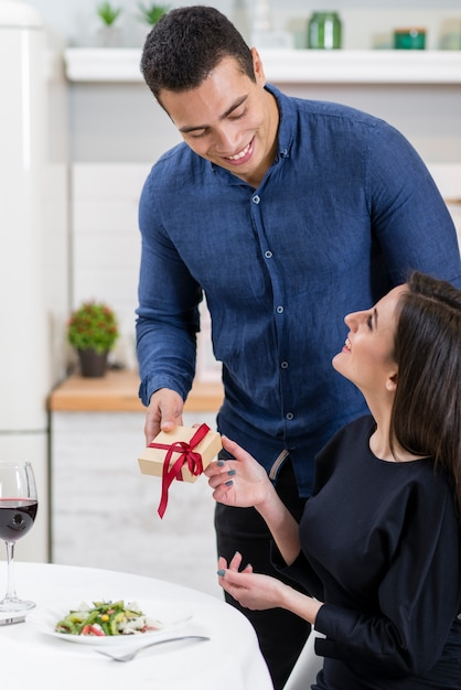 Man giving his wife a valentine's day present Free Photo