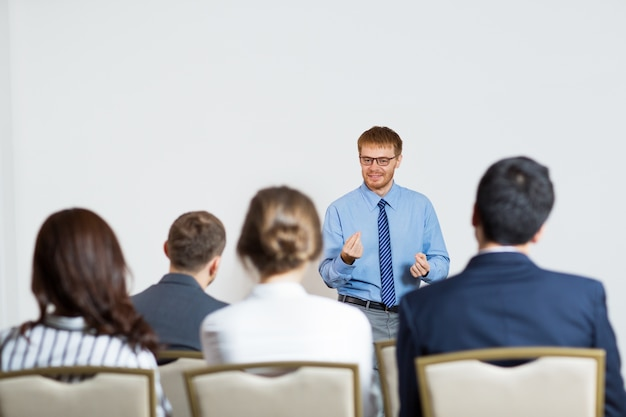Man giving a lecture to an audience Free Photo