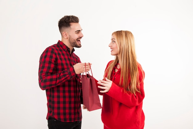 Man giving present to woman Free Photo
