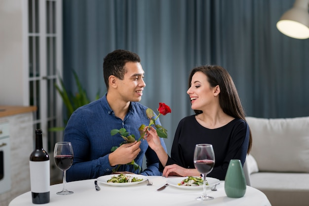 Man giving a rose to his beautiful girlfriend Free Photo