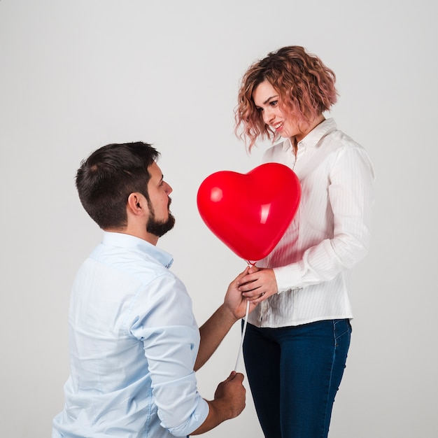 Man giving woman balloon for valentines Free Photo