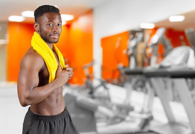 Man in gym Premium Photo