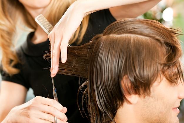 Man at the hairdresser Premium Photo