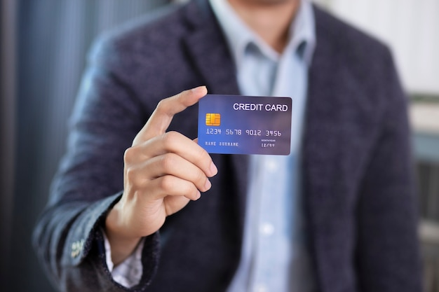 Man hand holding credit card wear suit jacket Premium Photo