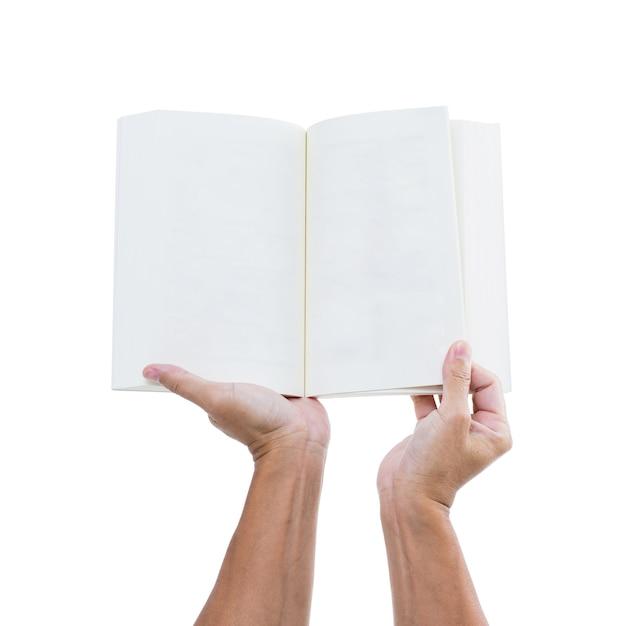 Рука человека, держащая открытую книгу, изолированные на белом фоне Premium Фотографии