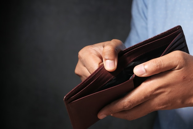 Premium Photo | Man hand open an empty wallet with copy space.