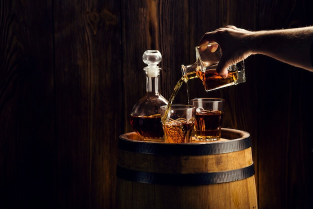 Man hand pouring alcoholic beverage into a glass Premium Photo