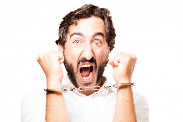 Man handcuffed with handcuffs police and screaming Free Photo