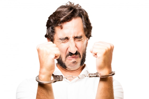Man handcuffed with handcuffs police Free Photo