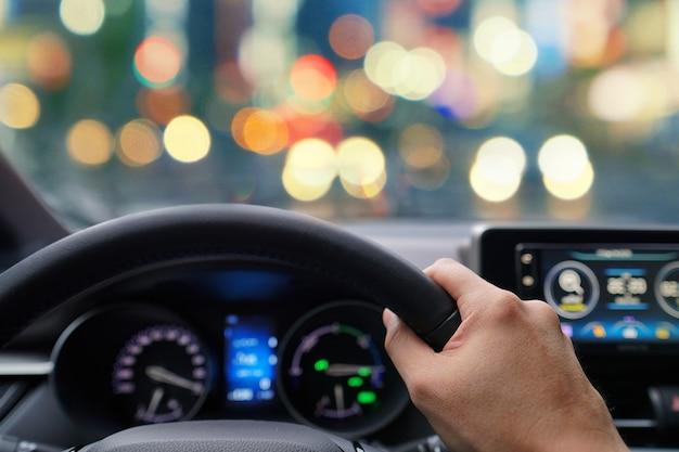 Man hands driver on steering wheel of a modern car Premium Photo