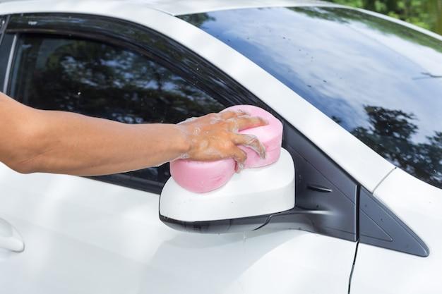 Man hands hold sponge for washing white car   Premium Photo