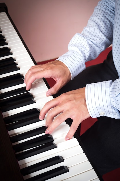 Man hands playing piano  music and art background Photo