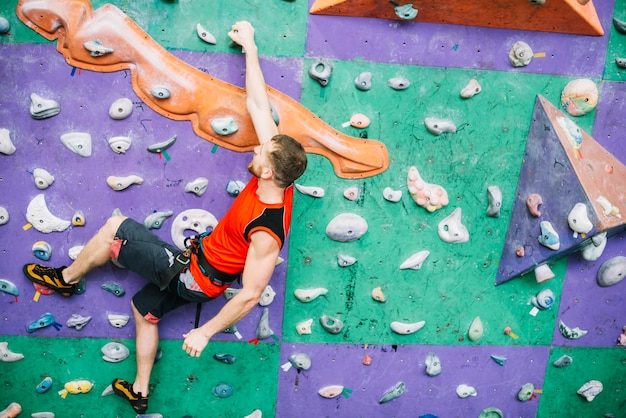 Man hanging on climbing wall 23 2147795566