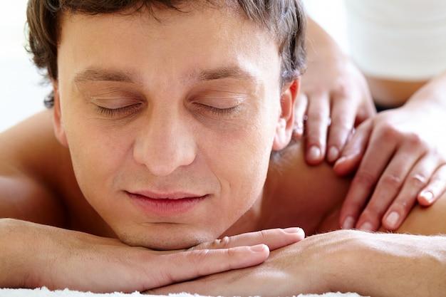 Man having body massage in spa salon Free Photo