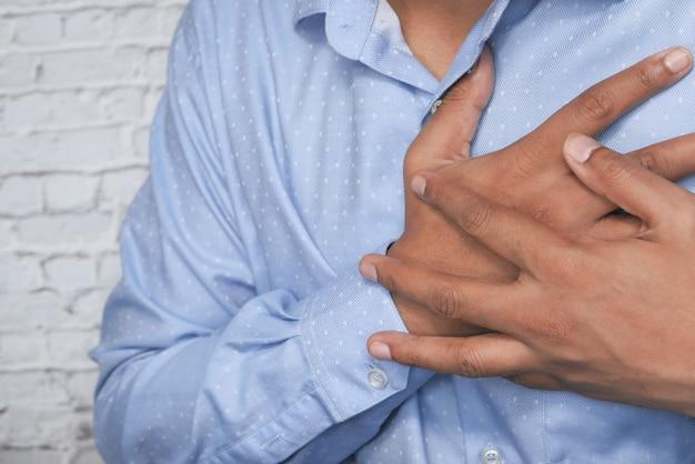 Man having chest pain, heart attack. Premium Photo