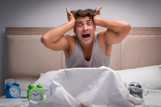 Man having trouble waking up in the morning Premium Photo