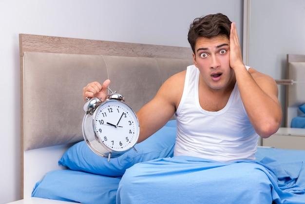 Man having trouble waking up in morning Premium Photo