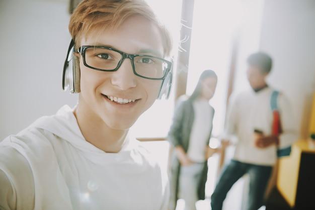 Man in headphones listen music in office Photo   Premium