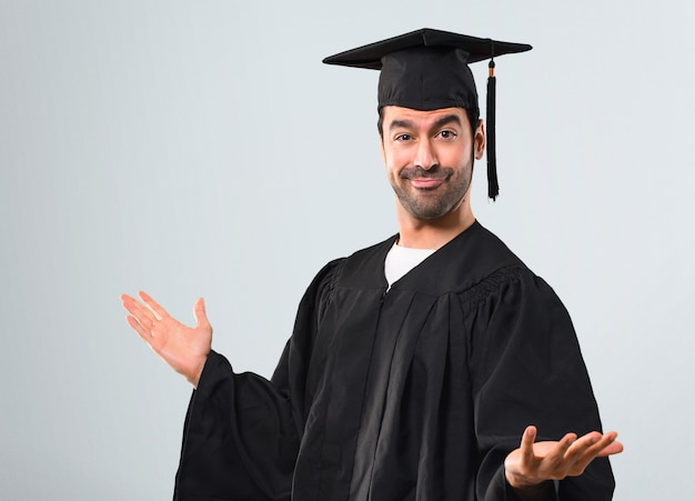 Man on his graduation day university proud and self-satisfied in love yourself concept Premium Photo