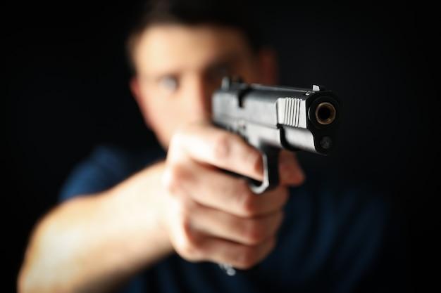 Man hold pistol. selective focus. self defense weapon Premium Photo