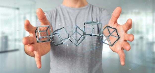 Man holding a 3d rendering blockchain cube isolated on a background Premium Photo