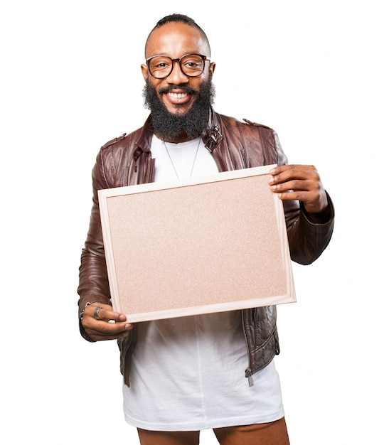 Man Holding A Board Photo