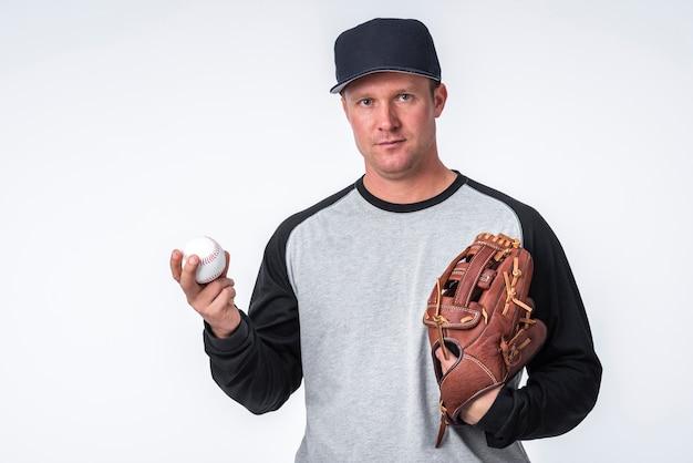 Man holding baseball and glove Free Photo