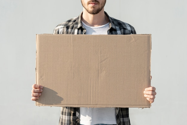 Man holding board with mock-up Premium Photo