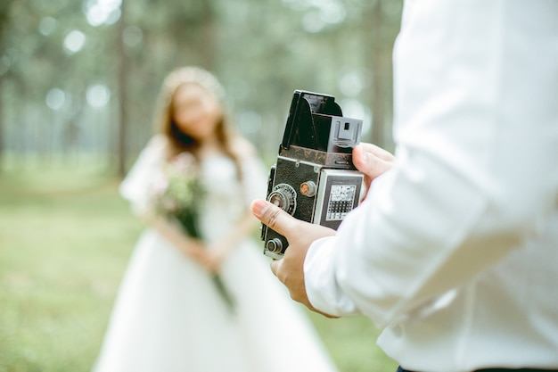 The man holding classic camera he standing beside his girlfriend Premium Photo