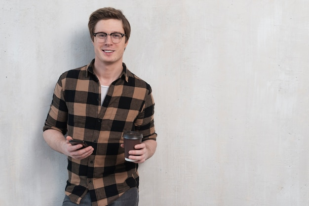 Man holding a cup of coffee with copy space Free Photo