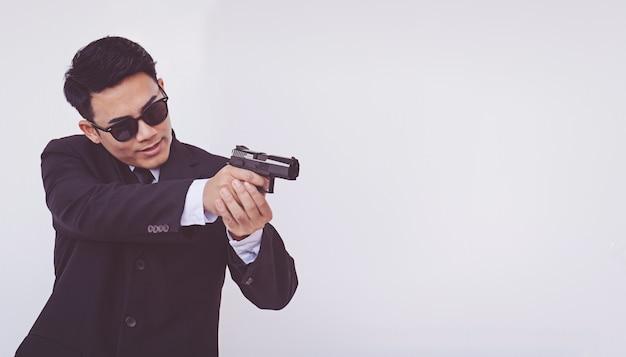 Man holding a gun, smart man Premium Photo