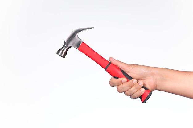 A man holding hammer on white background Premium Photo