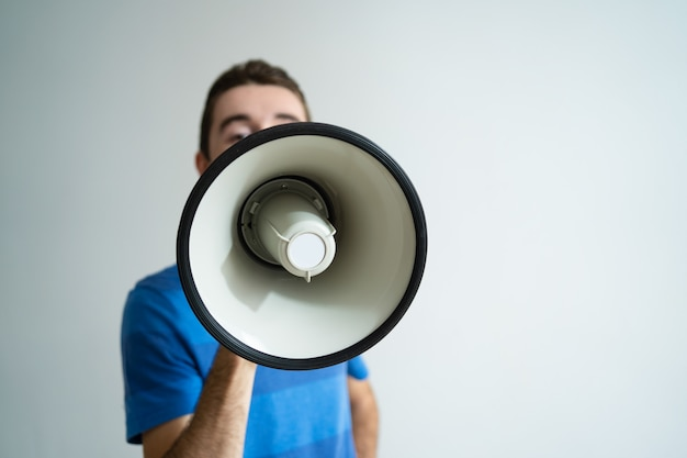 Man holding megaphone in front of his face Free Photo