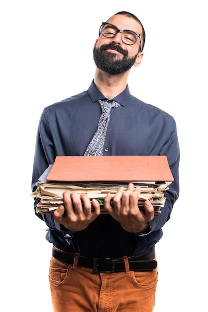 Человек, держащий несколько заметок колледжа Бесплатные Фотографии