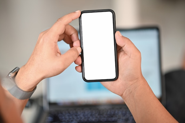 Man holding smart phone with blurred background. for graphic display montage. Premium Photo