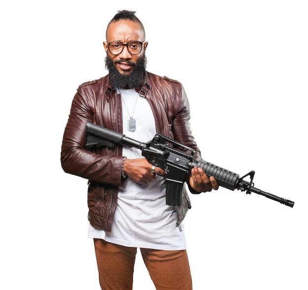 Man holding a submachine gun Free Photo