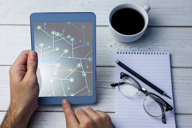 Man holding a tablet and working with it Free Photo