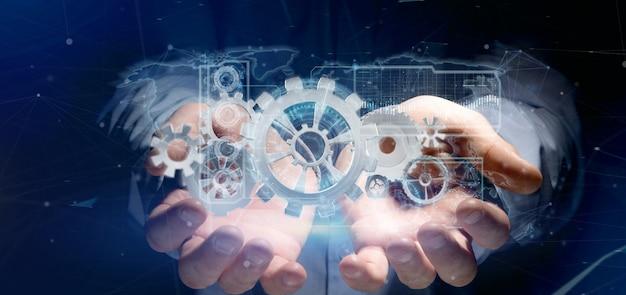 Man holding a technology gear wheel interface Premium Photo