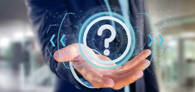 Man holding a technology question mark icon on a circle Premium Photo