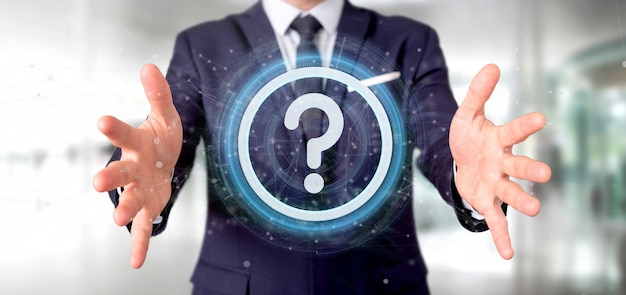 Man holding a technology question mark icon oncircle Premium Photo