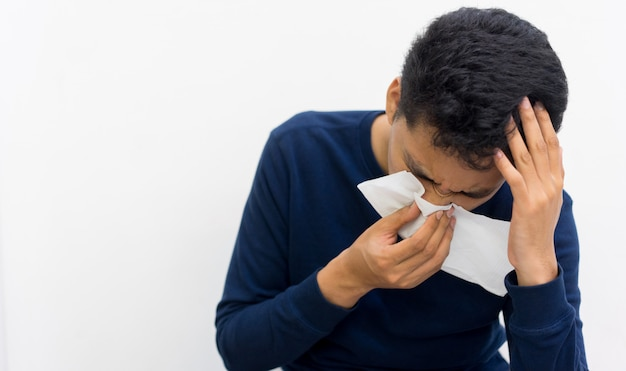 Man holding tissue in hand for reaction sneezing , healthy life concept Premium Photo