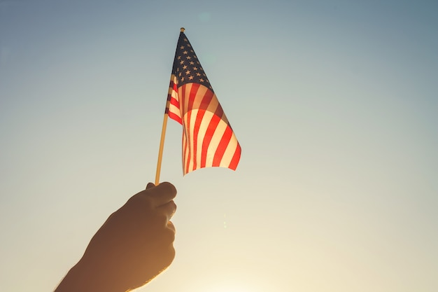 Man holding usa flag. celebrating independence day of america Premium Photo