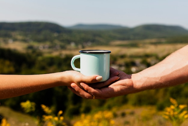 Man holding woman's hand and a cup of coffee Free Photo