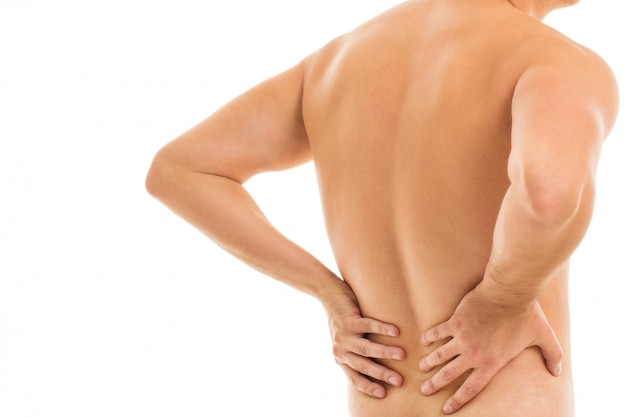 Man holds his back due to pain Free Photo