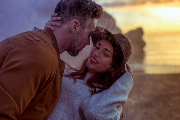 Man hugging woman on sea shore Free Photo