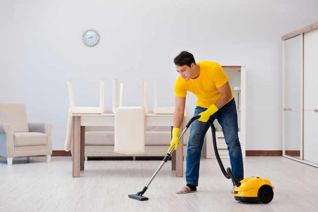 Man husband cleaning the house helping his wife Premium Photo